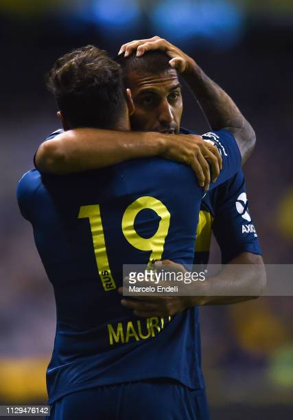 Mauro Zarate of Boca Juniors celebrates with teammate Ramón Ábila after scoring the first goal of his team during a match between Boca Juniors and...