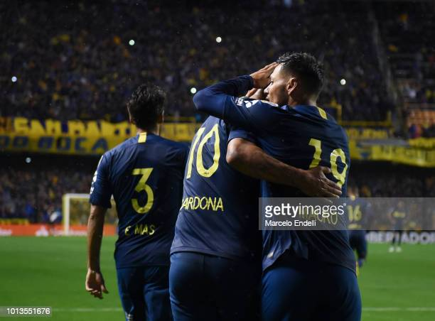 Mauro Zarate of Boca Juniors celebrates with teammates after scoring the second goal of his team during a round of sixteen first leg match between...