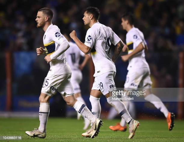 Mauro Zarate of Boca Juniors celebrates with teammates after scoring the second goal of his team during a match between Boca Juniors and Colon as...
