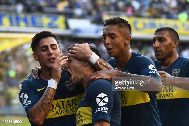 Mauro Zarate of Boca Juniors celebrates with teammates after scoring the second goal of his team during a match between Boca Juniors and Godoy Cruz...