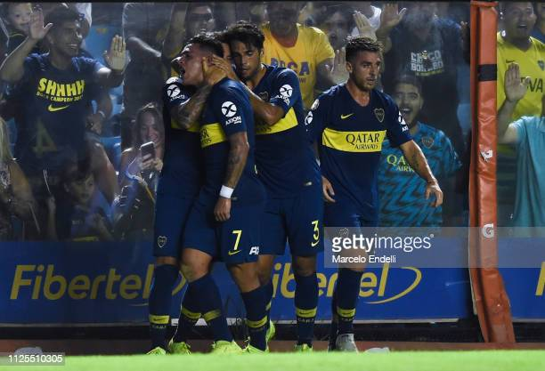 Mauro Zarate of Boca Juniors celebrates with teammates after scoring the second goal of his team during a match between Boca Juniors and Lanus as...