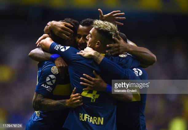 Mauro Zarate of Boca Juniors celebrates with teammates after scoring the first goal of his team during a match between Boca Juniors and San Lorenzo...