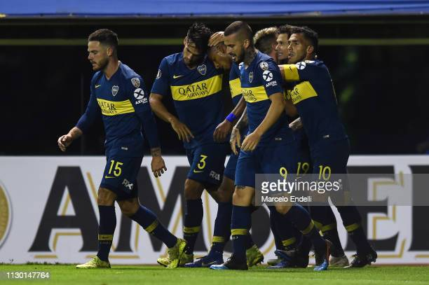 Mauro Zarate of Boca Juniors celebrates with teammates after scoring the third goal of his team during a group G match between Boca Juniors and...