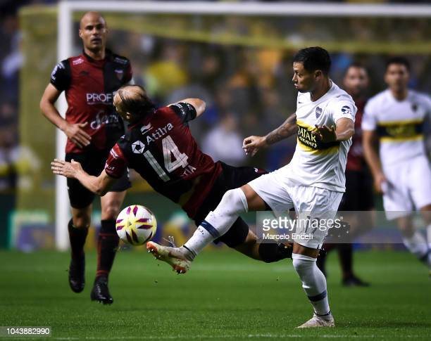 Mauro Zarate of Boca Juniors fights for the ball with Adrian Bastia of Colon during a match between Boca Juniors and Colon as part of Superliga...