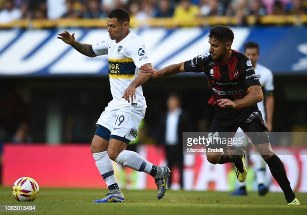 Mauro Zarate of Boca Juniors fights for the ball with Agustin Sandona of Patronato during a match between Boca Juniors and Patronato as part of...