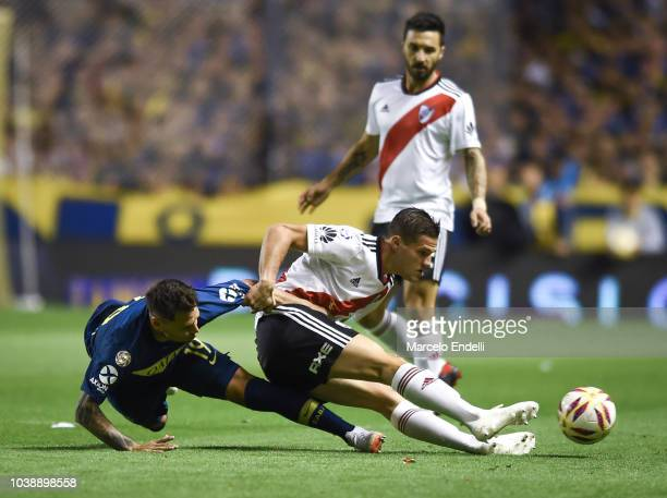 Mauro Zarate of Boca Juniors fights for the ball with Bruno Zuculini of River Plate during a match between Boca Juniors and River Plate as part of...