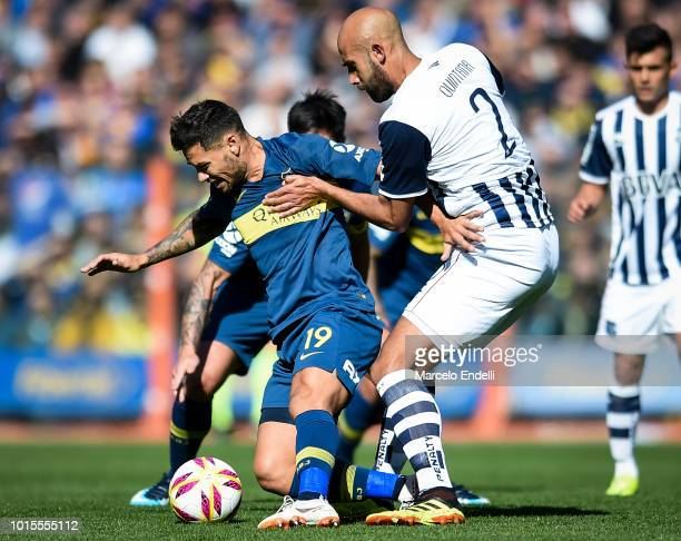 Mauro Zarate of Boca Juniors fights for the ball with Carlos Quintana of Talleres during a match between Boca Juniors and Talleres as part of...
