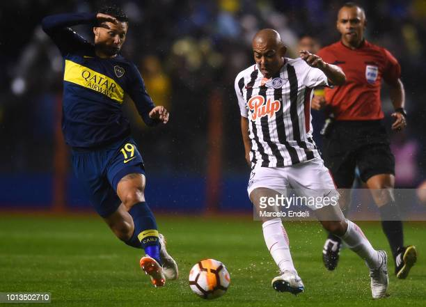 Mauro Zarate of Boca Juniors fights for the ball with Egidio Arevalo Rios of Libertad during a first leg match between Boca Juniors and Libertad as...