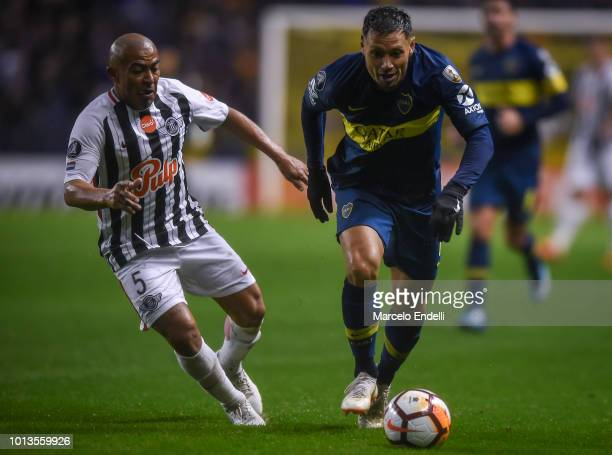 Mauro Zarate of Boca Juniors fights for the ball with Egidio Arevalo Rios of Libertad during a round of sixteen first leg match between Boca Juniors...