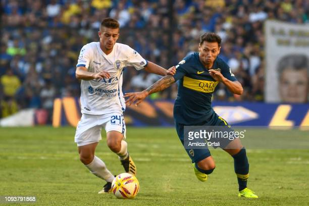 Mauro Zarate of Boca Juniors fights for the ball with Facundo Gutierrez of Godoy Cruz during a match between Boca Juniors and Godoy Cruz as part of...
