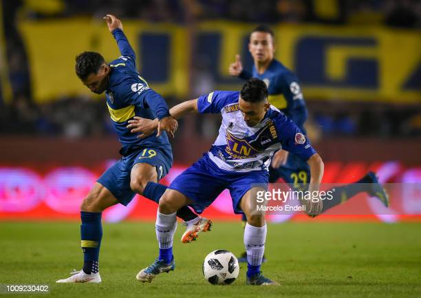Mauro Zarate of Boca Juniors fights for the ball with Francisco Molina of Alvarado during a match between Boca Juniors and Alvarado as part of Round...