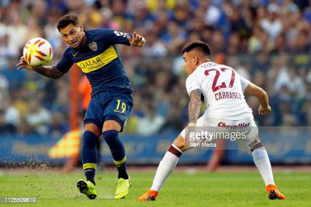 Mauro Zarate of Boca Juniors fights for the ball with Gabriel Carrasco of Lanus during a match between Boca Juniors and Lanus as part of Superliga...