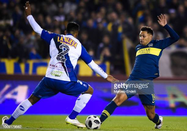 Mauro Zarate of Boca Juniors fights for the ball with German Mendoza of Alvarado during a match between Boca Juniors and Alvarado as part of Round of...