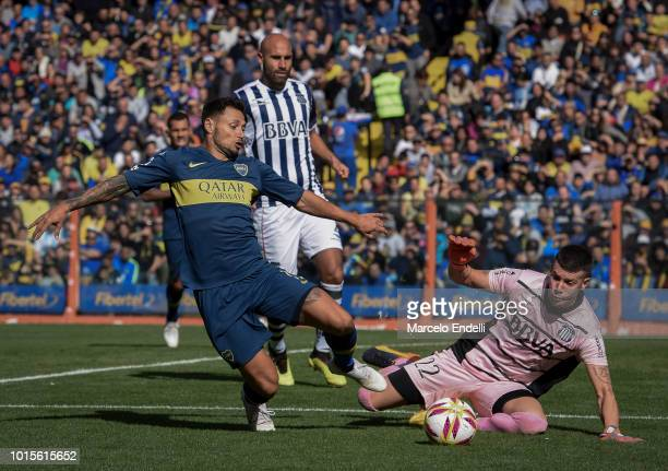 Mauro Zarate of Boca Juniors fights for the ball with Guido Herrera of Talleres during a match between Boca Juniors and Talleres as part of Superliga...