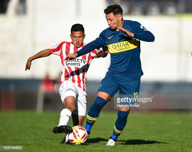 Mauro Zarate of Boca Juniors fights for the ball with Ivan Gomez of Estudiantes during a match between Estudiantes and Boca Juniors as part of...