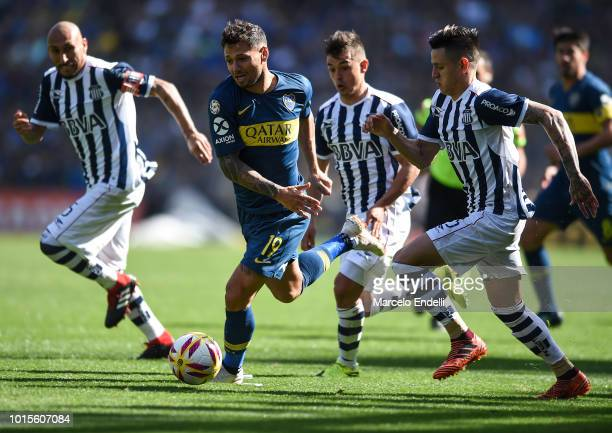 Mauro Zarate of Boca Juniors fights for the ball with Leonardo Godoy of Talleres during a match between Boca Juniors and Talleres as part of...