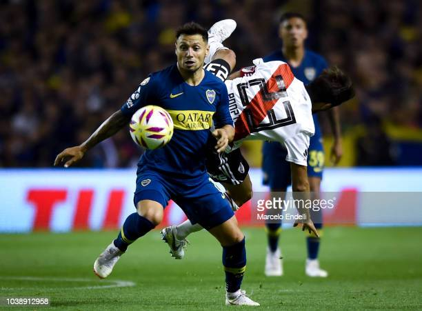 Mauro Zarate of Boca Juniors fights for the ball with Leonardo Ponzio of River Plate during a match between Boca Juniors and River Plate as part of...