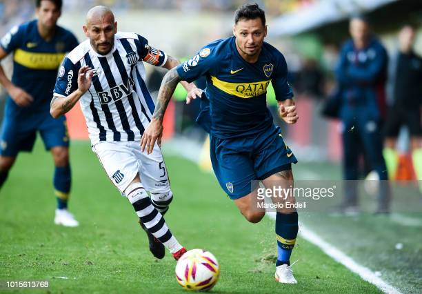 Mauro Zarate of Boca Juniors fights for the ball with Pablo Guinazu of Talleres during a match between Boca Juniors and Talleres as part of Superliga...