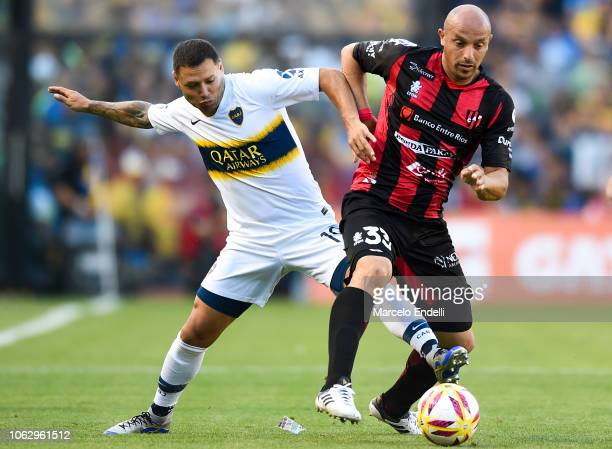 Mauro Zarate of Boca Juniors fights for the ball with Renzo Vera of Patronato during a match between Boca Juniors and Patronato as part of Superliga...