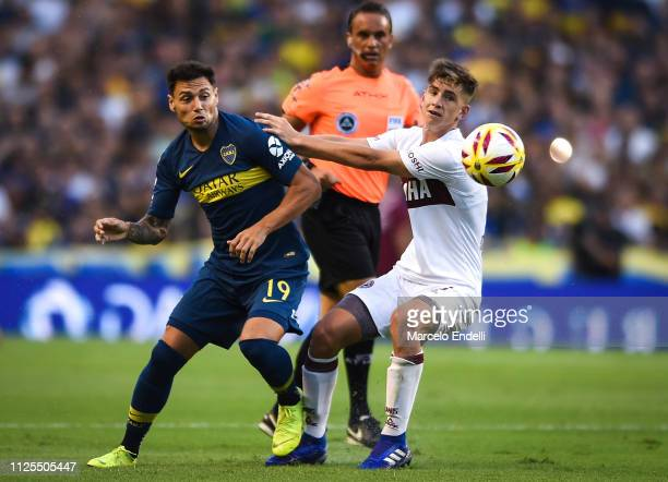 Mauro Zarate of Boca Juniors fights for the ball with Tomas Belmonte of Lanus during a match between Boca Juniors and Lanus as part of Superliga...