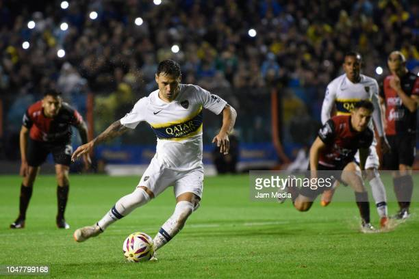 Mauro Zarate of Boca Juniors kicks a penalty to score the second goal of his team during a match between Boca Juniors and Colon as part of Superliga...