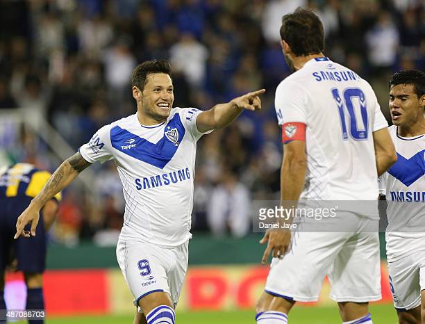 Mauro Zarate of Velez Sarsfield celebrates with his teammates after scoring the opening goal during a match between Velez Sarsfield and Rosario...