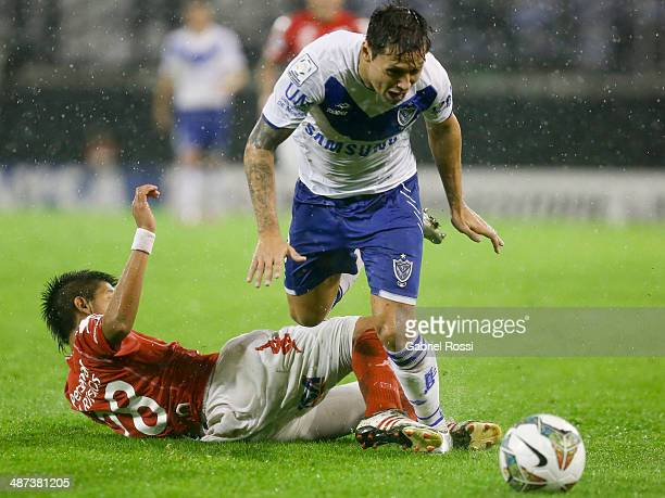 Mauro Zarate of Velez Sarsfield fights for the ball with Derlis Orue of Nacional during a match between Velez Sarsfield and Nacional as part of round...