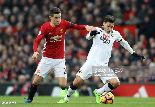 Mauro Zarate of Watford and Ander Herrera of Manchester United compete for the ball during the Premier League match between Manchester United and...