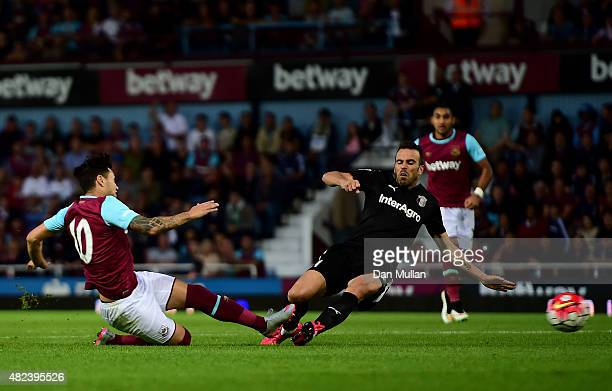 Mauro Zarate of West Ham scores his side's second goal during the UEFA Europa League third qualifying round match between West Ham United and Astra...
