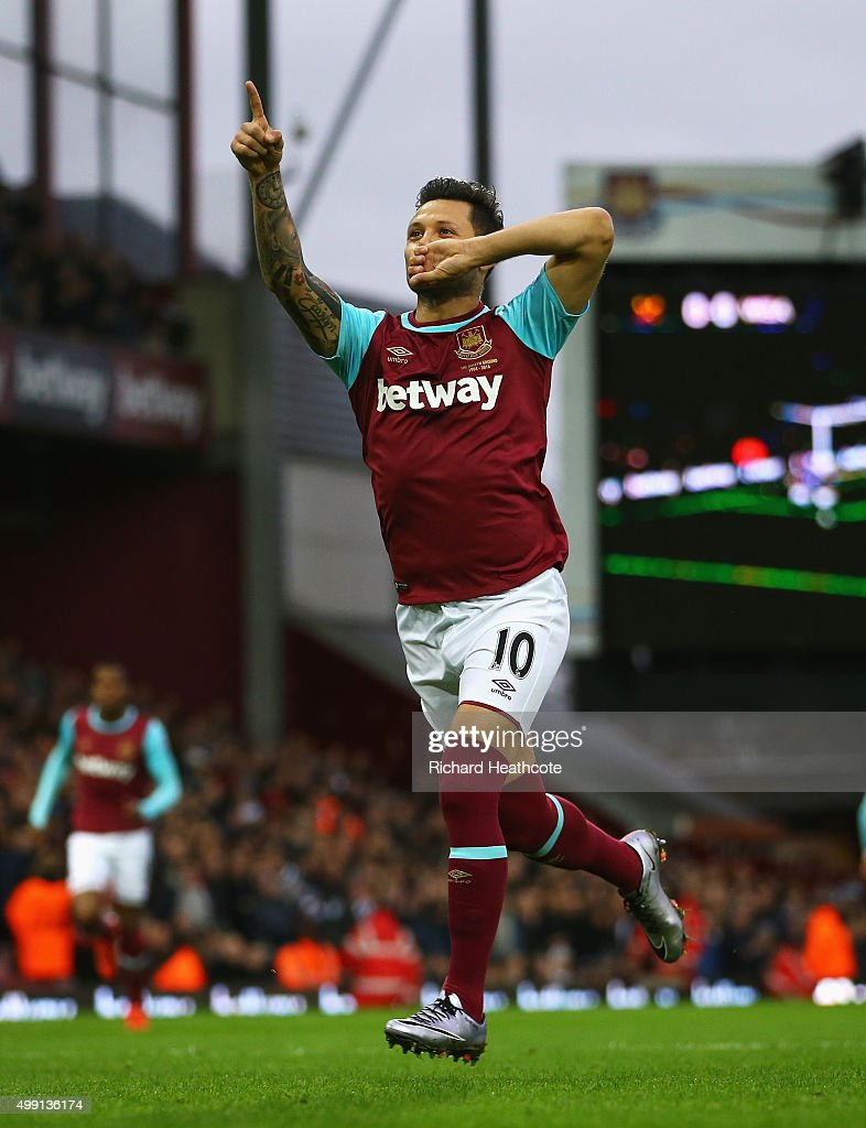 Mauro Zarate of West Ham United celebrates as he scores their first goal from a free kick during the Barclays Premier League match between West Ham United and West Bromwich Albion at Boleyn Ground on November 29, 2015 in London, England.