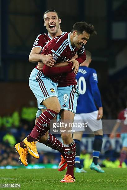 Mauro Zarate of West Ham United celebrates his goal with Andy Carroll during the Barclays Premier League match between Everton and West Ham United at...