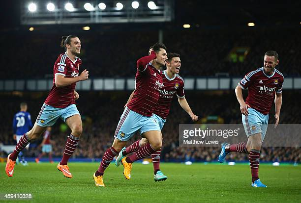 Mauro Zarate of West Ham United celebrates his goal with team mates during the Barclays Premier League match between Everton and West Ham United at...