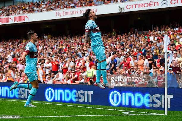 Mauro Zarate of West Ham United celebrates in front of the travelling fans as he scores their second goal during the Barclays Premier League match...
