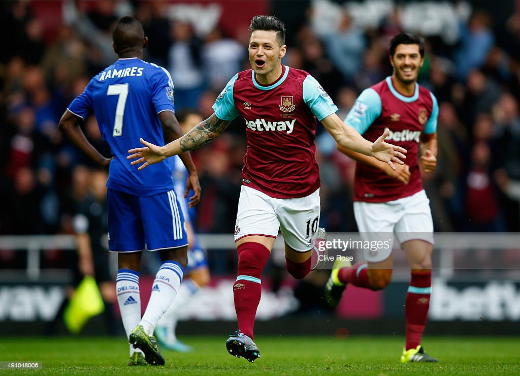 Mauro Zarate of West Ham United celebrates scoring his team's first goal during the Barclays Premier League match between West Ham United and Chelsea at Boleyn Ground on October 24, 2015 in London, England.