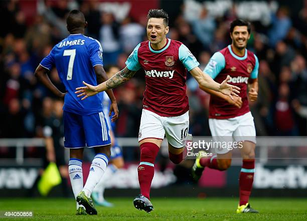 Mauro Zarate of West Ham United celebrates scoring his team's first goal during the Barclays Premier League match between West Ham United and Chelsea...