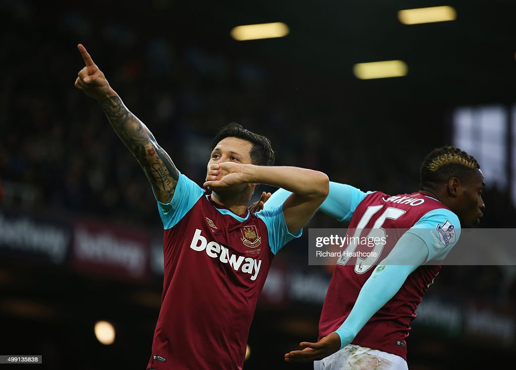 Mauro Zarate of West Ham United (L) celebrates with Diafra Sakho as he scores their first goal from a free kick during the Barclays Premier League match between West Ham United and West Bromwich Albion at Boleyn Ground on November 29, 2015 in London, England.