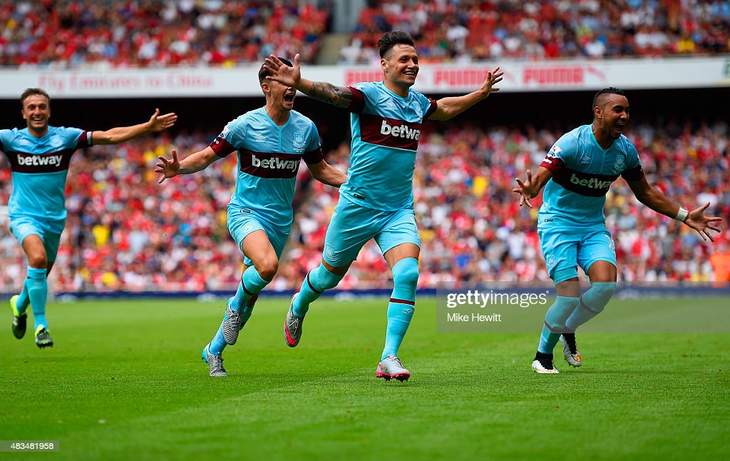 Mauro Zarate of West Ham United (2R) celebrates with team mates as he scores their second goal during the Barclays Premier League match between Arsenal and West Ham United at the Emirates Stadium on August 9, 2015 in London, England.