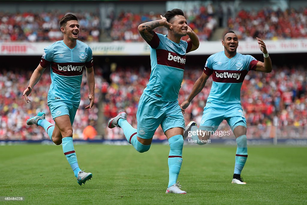 Mauro Zarate of West Ham United (C) celebrates with team mates as he scores their second goal during the Barclays Premier League match between Arsenal and West Ham United at the Emirates Stadium on August 9, 2015 in London, England.