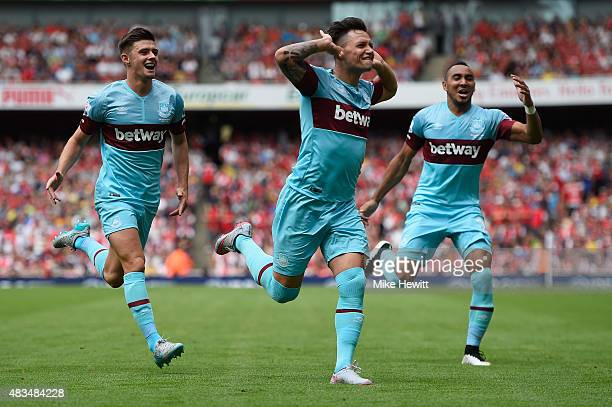 Mauro Zarate of West Ham United celebrates with team mates as he scores their second goal during the Barclays Premier League match between Arsenal...