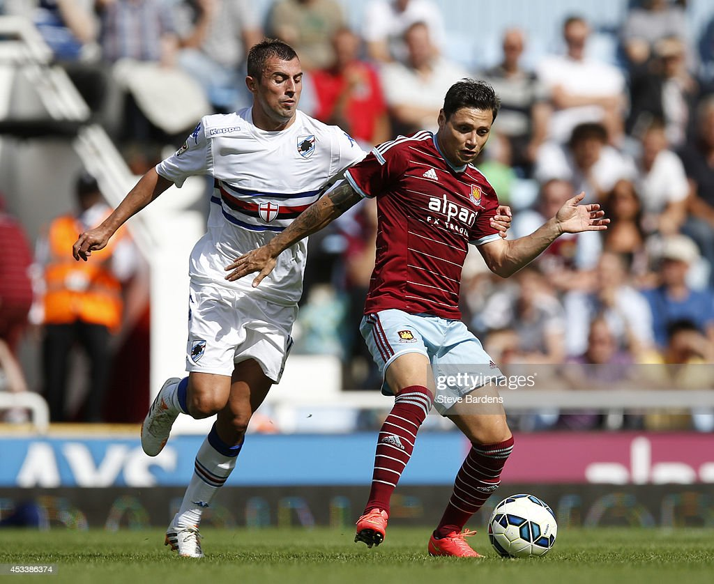 Mauro Zarate of West Ham United is tackled by Nenad Krsticic of Sampdoria during the pre-season friendly match between West Ham United and Sampdoria at Boleyn Ground on August 9, 2014 in London, England.
