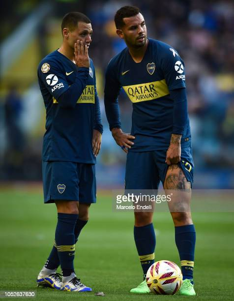 Mauro Zarate talks with teammate Edwin Cardona during a match between Boca Juniors and Rosario Central as part of Superliga 2018/19 at Alberto J...