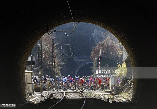 Cyclists ride during the fourth stage of the 65th edition of the Paris-Nice cycling race between Maurs and Mende, 15 March 2007. Spain's Alberto...