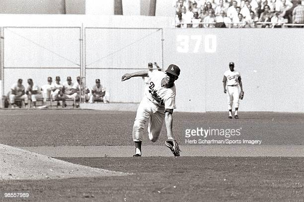 Maury Wills of the Los Angeles Dodgers fields a ball during the 1965 World Series against the Minnesota Twins on October 10 1965 in Dodger Stadium in...