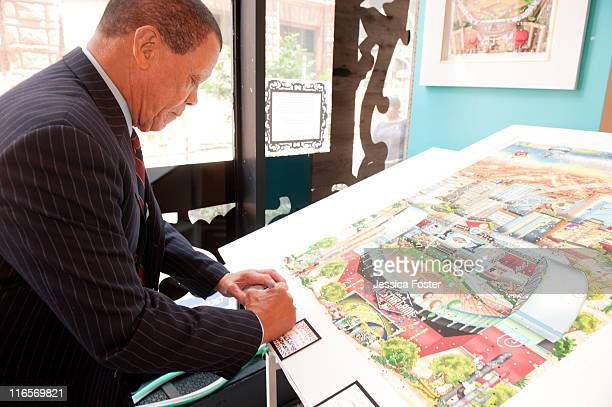 Maury Wills writes his favorite baseball memory on a card that will eventually be incorporated into a three-dimensional piece of art by Charles...