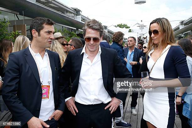 CEO Maus Freres International / Lacoste Thierry Guibert Actor Hugh Grant and Anna Eberstein attend the 2015 Roland Garros French Tennis Open at...
