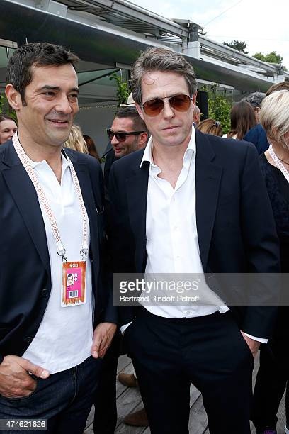 CEO Maus Freres International / Lacoste Thierry Guibert and Actor Hugh Grant attend the 2015 Roland Garros French Tennis Open at Roland Garros on May...
