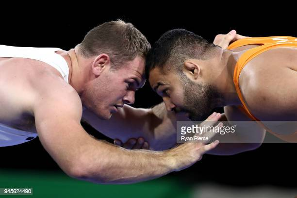 Mausam Khatri of India competes against Martin Erasmus of South Africa during the Men's Freestyle 97 kg Gold Medal match on day nine of the Gold...