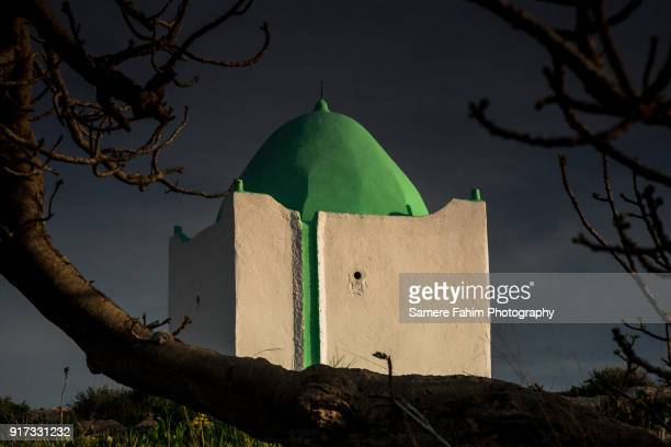 mausoleum of sidi mohamed el borzini against blue sky - samere fahim stock photos and pictures