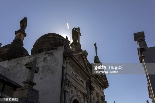 mausoleums at a cemetery - mass stock pictures, royalty-free photos & images