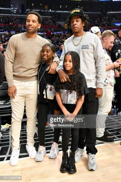 Maverick Carter, Lyra Carter, Jay-Z and Blue Ivy Carter attend a basketball game between the Los Angeles Clippers and the Los Angeles Lakers at...